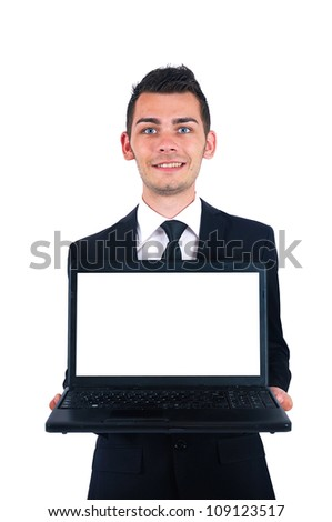 Isolated young business man presenting laptop