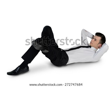 Isolated young business man relaxing