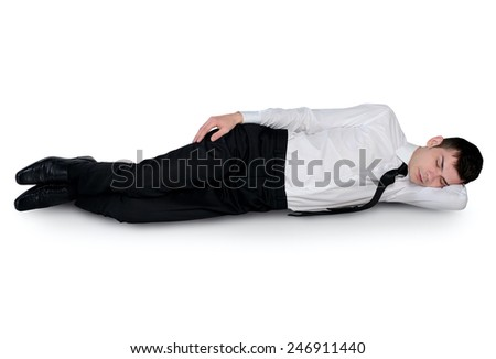 Isolated young business man sleeping - stock photo