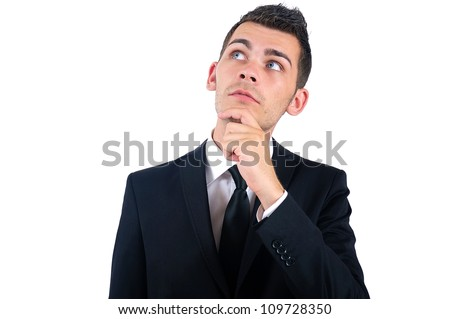 Isolated young business man thinking