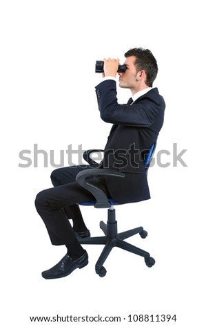 Isolated young business man with binocular - stock photo
