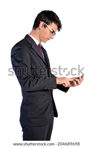 Isolated young business man with phone - stock photo