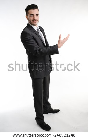 isolated young business man with positive attitude convincing with his hands - stock photo