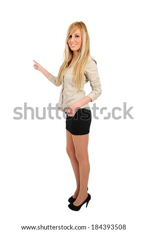 Isolated young business woman pointing back