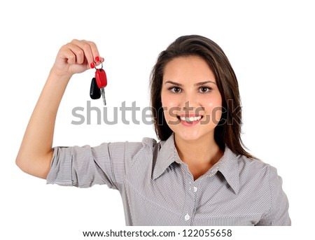 Isolated young business woman showing keys - stock photo