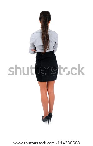 Isolated young business woman standing back view - stock photo