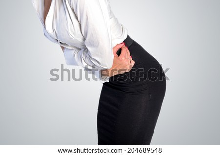 Isolated young business woman stomach ache - stock photo