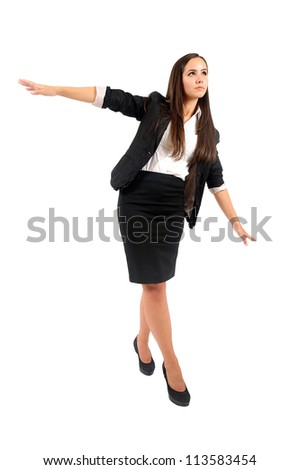 Isolated young business woman walking on rope - stock photo