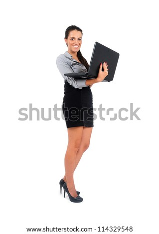 Isolated young business woman with laptop - stock photo