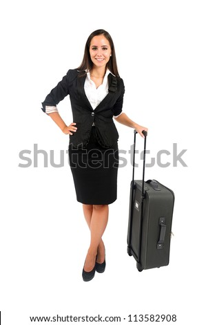 Isolated young business woman with luggage - stock photo