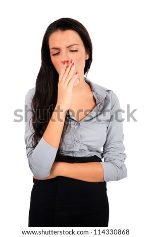 Isolated young business woman yawn - stock photo