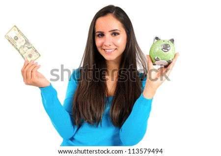 Isolated young casual girl with piggybank and banknote - stock photo