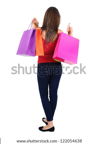 Isolated young casual girl with shopping bag - stock photo