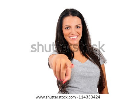 Isolated young casual woman pointing camera - stock photo