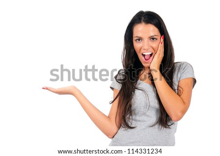 Isolated young casual woman presenting - stock photo