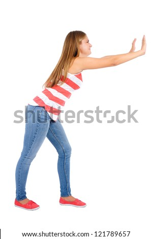 Isolated young casual woman push something