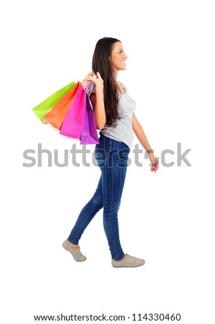 Isolated young casual woman walking - stock photo