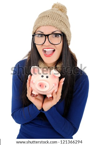 Isolated young casual woman with piggy bank - stock photo