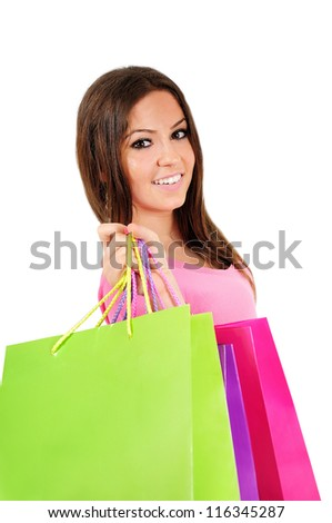 Isolated young casual woman with shopping bag