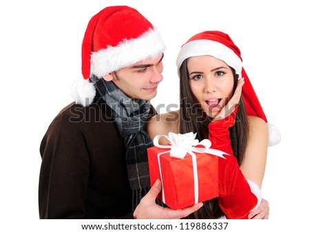 Isolated Young Christmas Couple With Gift
