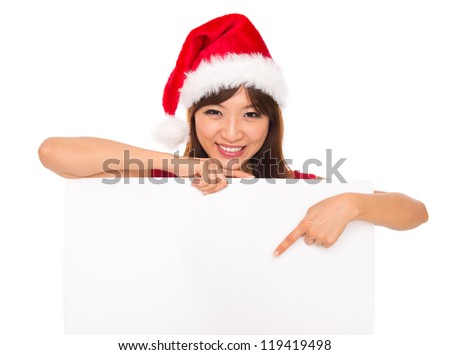 Isolated young christmas woman pointing at a blank sign - stock photo