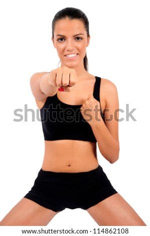 Isolated young fitness girl with focus on face - stock photo