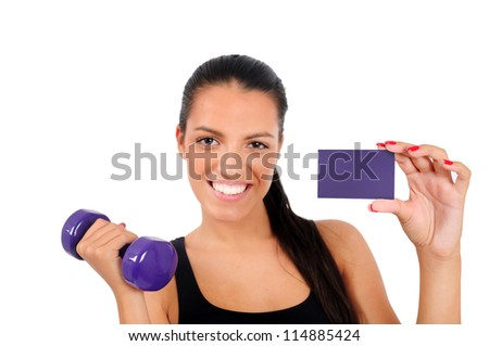Isolated young fitness woman with dumbbell and business card - stock photo