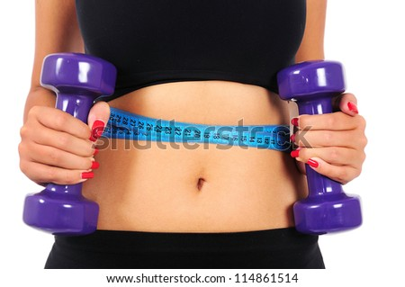 Isolated young fitness woman with dumbbell and measuring tape - stock photo