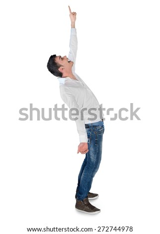 Isolated young man winner pointing up - stock photo