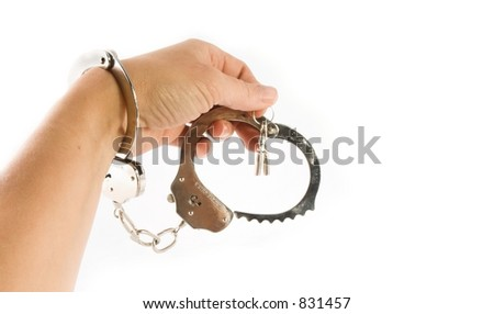 isolatedhand and  handcuffs with keys