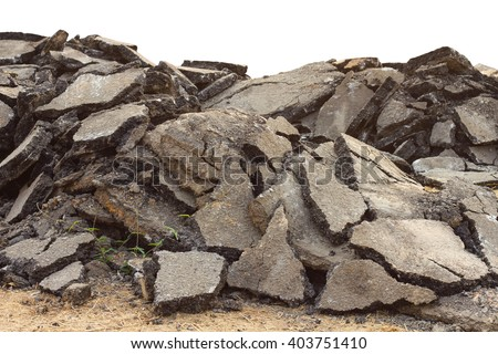 Isolates background ensemble pieces of asphalt road which lay heaped on the ground to be recycled. - stock photo