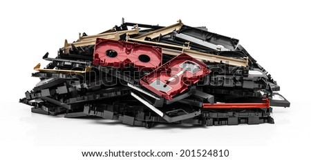 Isolates of VHS video cassette was disassembled pile together. - stock photo