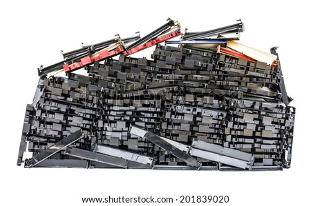 Isolates of VHS video cassette was disassembled piles  in a row  together   - stock photo