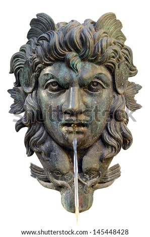 Isolation Of An Ornate Water Fountain With Mythological Face - stock photo
