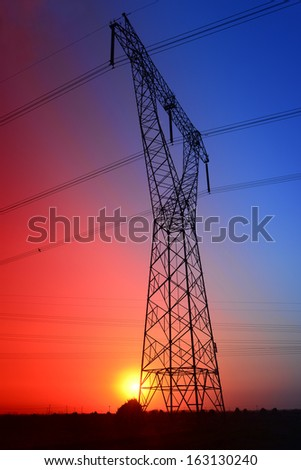 Isolation of high voltage towers under the setting sun