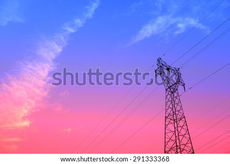 Isolation of high voltage towers under the setting sun, close-up