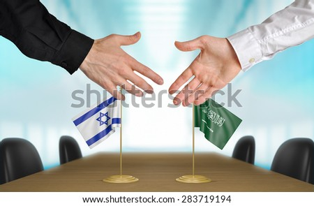 Israel and Saudi Arabia diplomats agreeing on a deal - stock photo