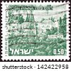 "ISRAEL - CIRCA 1971: A stamp printed in Israel from the ""Landscapes"" issue shows Rosh Pinna town, circa 1971. - stock photo"