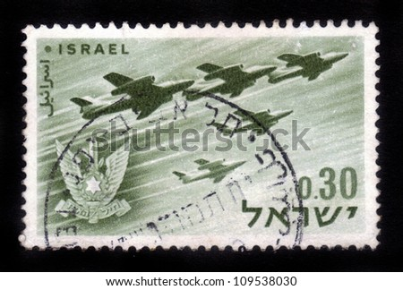 ISRAEL - CIRCA 1962: A stamp printed in Israel, shows a Israeli aircraft - bombers and military emblem - Israel's air force, Israel, series, circa 1962