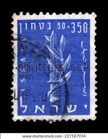 ISRAEL - CIRCA 1957: A stamp printed in Israel shows the emblem of the Haganah, Jewish paramilitary organization, series Security of Israel, blue, circa 1957 - stock photo