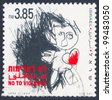 """ISRAEL - CIRCA 1994:  An old used Israeli Postage stamp issued in honor of the combating violence in the world with inscription: """"No to Violence""""; series, circa 1994 - stock photo"""