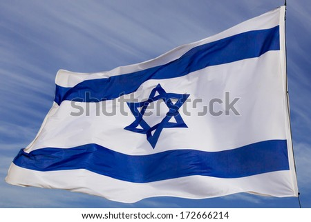 Israel flag flapping in the wind isolated against the sky - stock photo