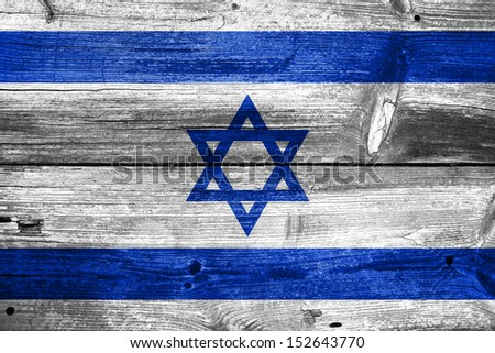 Israel flag painted on old wood plank background - stock photo