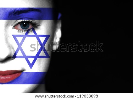 Israel flag painted on woman face - stock photo