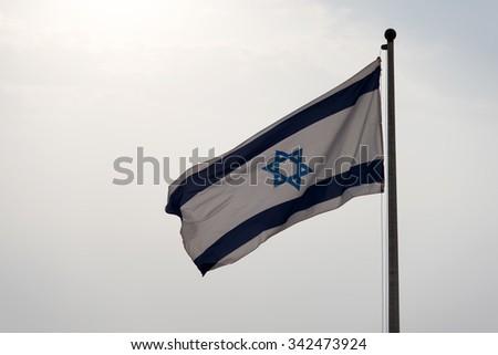 Israel flag waving - stock photo