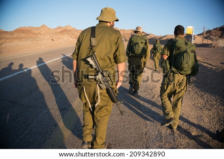 Israeli army patrol in middle east war - stock photo