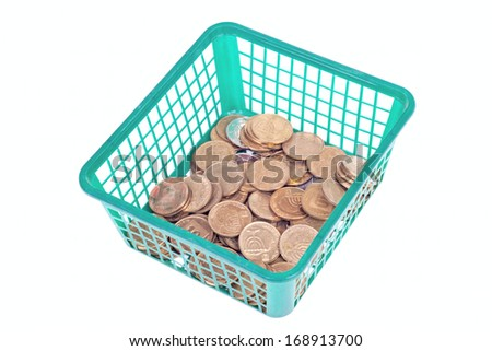 Israeli coins in green basket isolated on white background - stock photo