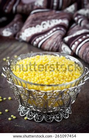 Israeli couscous ptitim, unprepared, dry, healthy cereals, tasty diet ingredient - stock photo