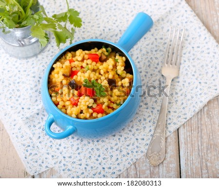 Israeli couscous (Ptitim) with vegetables, top view