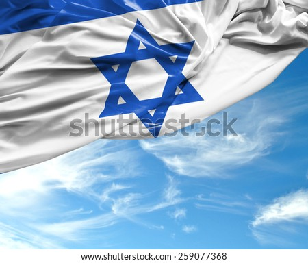 Israeli waving flag on a beautiful day - stock photo